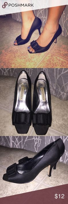 Caparros peep toe pumps. Very classy and sophisticated black satin pumps. Slightly worn but good condition! Approx 3 inch pumps. Would describe as a bit more on the formal side. Perhaps more suitable for wedding, funeral, or black tie affair. Would wear nicely with little black dress. Caparros Shoes Heels