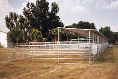 Roof panels can be added to pipe corral panels to provide your horse shelter with cool shade in the summer and protection from the rain in the winter. Show Cattle Barn, Horse Pens, Horse Corral, Horse Shelter, Horse Barn Plans, Horse Property, Horse Ranch, Dream Barn, Horse Stalls
