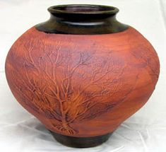 celtic clay pot with tree on one side (other images imposed on the pot all related to Danu Weapons)