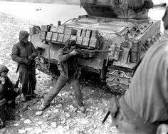 Browning Automatic Rifle in action.check out the supply of ammo boxes on back of that tank, so unreal