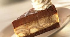 By incorporating Kahlua, the rum & coffee liqueur, into a delicious cheesecake filling mixture and sandwiching it between a rich chocolate brownie and a coffee-infused chocolate mousse you have a dessert that is delicioso as they say in Veracruz, Mexico, the home of Kahlua.