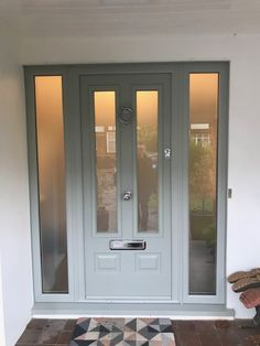 Check out this new Edinburgh Solidor in Painswick Green and Matching frames. Taking Solidor Composite Doors to the next level. What an installation in New Malden Solidor Composite Porch Uk, Front Door Porch, Grey Front Doors, Porch Doors, Front Porch Design, Modern Front Door, Front Door Entrance, Exterior Front Doors, House Front Door