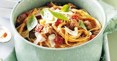 Our take on spaghetti and meatballs is made with sausages and a creamy tomato sauce.