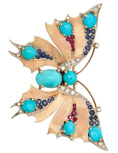 VAN CLEEF & ARPELS PARIS Gold Butterfly Brooch Pendant, An elegant 18K gold butterfly brooch by Van Cleef & Arpels - Paris, with a uniquely patterned hand engraved surface, set with diamonds, turquoise, sapphires, and rubies. France 1950s.