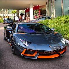 Lamborghini Aventador coupe painted in Grigio Estoque w/ Orange accents  Photo taken by: @exoticars_sg on Instagram