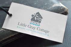 Create a logo for Little Gray Cottage, a beach vacation rental home. by Alex Romanov