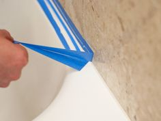 Once in a while, bathtub caulking needs a touch-up.  Applying blue painter's tape to both sides of the caulking line beforehand ensures a straight line and minimizes the mess. #HomeHints