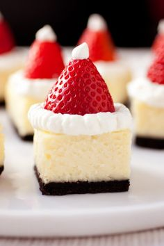 Santa Hat Cheesecake Bites - these are a hit at parties. Festive and delicious! Santa Hat Cheesecake Bites - these are a hit at parties. Festive and delicious! Christmas Party Food, Xmas Food, Christmas Cooking, Christmas Treats, Holiday Treats, Christmas Hat, Chrismas Food Ideas, Christmas Cakes, Merry Christmas