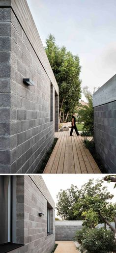This modern house used raw concrete blocks and a concrete roof in its construction. Wood paths lead you around the house.