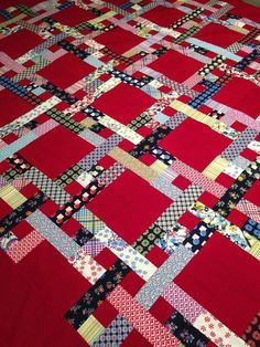 What a great scrap quilt and I love the red background!