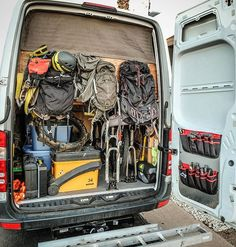 """A lot of folks ask where I store all of my adventure gear when they walk into the living area of Betty White. This is my """"garage"""". There's a mountain bike, my touring bike, all of my backpacking and camping gear, a standup paddle board and paddle, clothes for all seasons, climbing gear, extra parts for the van and bikes, gear for motocross and all of my packs in there. I have about 140 cubic feet of storage space just under the bed. You can find more pictures of the van via the link in my…"""