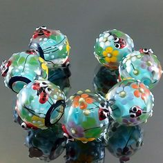 PIKALDA=handmade lampwork 7 glass beads ladybug flower blossom=SKY BLUE DAY=SRA