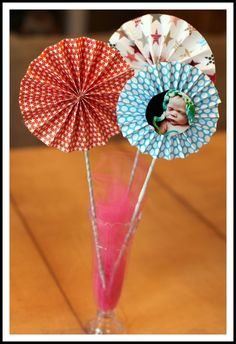 maybe do a garland with these and pics of each month on each pinwheel?