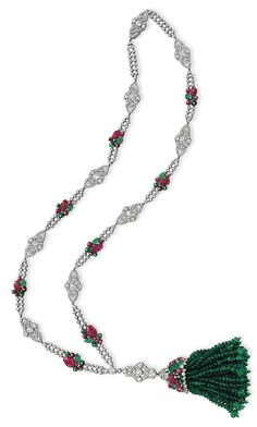 AN ART DECO TUTTI FRUTTI DIAMOND, EMERALD AND RUBY SAUTOIR, BY BOUCHERON. Mounted in platinum and 18k gold, with French assay marks and maker's marks, circa 1925, signed Boucheron, Paris.