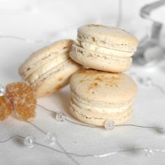 Gingerbread spiced macarons with spiced, creamy buttercream filling and a small piece of crystallised ginger in the middle