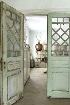 Gorgeous repurposed doors as room divide.