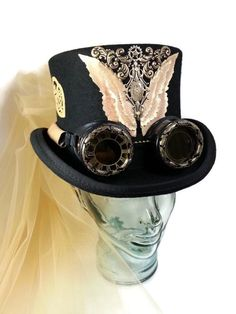 Hat has a custom cut leather wings highlighted in gold and bronze pearl with resin finished watch face in art deco frame and swarovski crystal. Description from etsy.com. I searched for this on bing.com/images