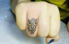 Owl tattoo on finger. I wouldn't get it on my finger but maybe my inner wrist