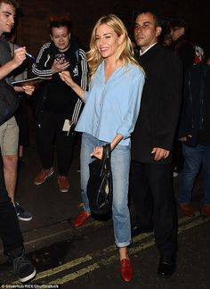 In demand: Sienna Miller signed autographs outside London's Apollo Theatre stage door after finishing another performance of Cat On A Hot Tin Roof on Wednesday