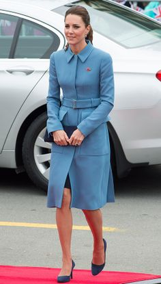 All eyes are on the Duchess this week as she begins the Royal tour! And so far, she's doing her wardrobe justice, appearing in a perfectly tailored cornflower blue Alexander McQueen coat with subtle peplum detail. Dark navy heels and sapphire drop earrings completed the Royal look.