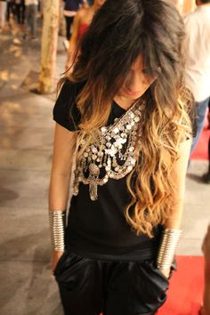 Ethnic statement piece over a black tee. Perfection. Amazing hair too! (Madame de Rosa)