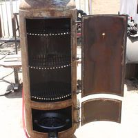 Resultado de imagen para how to make smoker out of propane tank Barrel Smoker, Bbq Pit Smoker, Propane Smokers, Propane Tanks, Best Portable Grill, Build A Smoker, Diy Wood Stove, Ugly Drum Smoker, Bbq Smoker Trailer