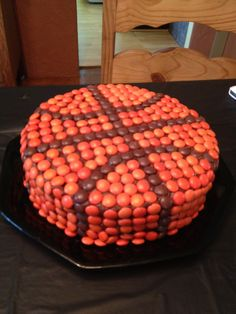 Basketball Cake Trent and I Made for Trey's Party Just a double layer cake with chocolate frosting. Then used Reece Pieces to decorate.