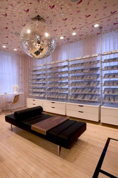"""Shoe closet - WANT. The very first YMCA in the U.S. got a face-lift, after """"The Apartment"""" designers completely converted its 7,000 square foot, basketball court and running track into a 5-bedroom luxury apartment."""