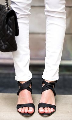 Wedge espadrille sandals with elegantly twisted black fabric straps