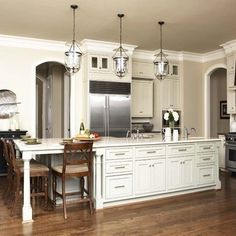 Long Kitchen Island - Love the drawers on the side with doors.  Put warming oven and wine cooler in island.  Like the chairs at end - do we want on long side or at end?