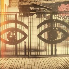 Steel gate with Olle Eksell's eyes.
