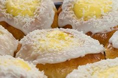 Skolebrød - Norwegian custard buns (skolebrød)  http://www.bbc.co.uk/food/recipes/norwegian_custard_buns_92546  These buns are a traditional children's treat. This version adds a splodge of homemade raspberry jam to the classic custard-stuffed cardamom buns, topped with desiccated coconut.  Equipment and preparation: you will need a free-standing electric mixer fitted with a dough hook.  Over 2 hours preparation time 10 to 30 mins cooking time Makes 12