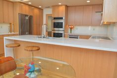 Rift White Oak With A Vertical Grain Was Chosen For The Cabinets To Add To  The Height Of The Space.