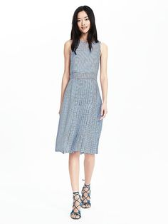 Keep it effortlessly chic this Summer with our elegant 100% silk gingham print dress from our exclusive capsule collection by emerging artist Timo Weiland. This sleeveless blue print crewneck dress will be your go to Summer dress. Perfect for a day time wedding or a casual dinner al fresco with friends | Banana Republic