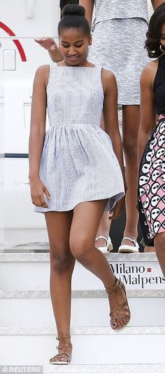 Sasha and Malia Obama shop in Milan after flying in on Air Force One