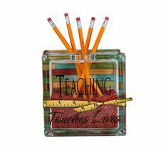 Teaching Touches Lives glass block.