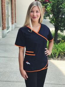 Denver Broncos Mock Wrap Scrub Top with Two Front Pockets Dental Scrubs, Medical Scrubs, Scrubs Outfit, Scrubs Uniform, Cute Nursing Scrubs, Denim Skater Dress, Scrubs Pattern, Denver Broncos Womens, Stylish Scrubs