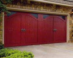 I simply love barn door style garage doors. And, there is a gorgeous red color on these. Red Garage Door, Cheap Garage Doors, Garage Doors Prices, Garage Door Colors, Garage Door Sizes, Garage Door Company, Garage Door Windows, Garage Door Makeover, Front Doors
