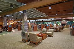 A focus of the Rockmart Library, GA, is a fireplace composed of local and unique Rockmart stone that also wraps the interior columns. Ceiling baffles and wooden slats diffuse sound for a relaxed reading experience. CREDITS: CAS Architecture, architect; photo, Robins Photography, Inc.