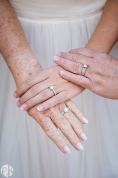 Three stunning wedding rings represent three generations of happy marriage. Beautiful wedding photography from this military Air Force wedding.