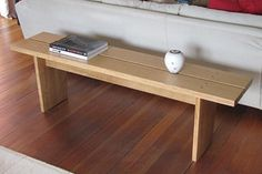 OAK BENCH - A multi purpose bench made in English oak, with a quarter sawn oak top.  The published price is only a guide as this bench can be made to order in a variety of woods to suit your own interior and room sizes.  Please get in touch if you would like to chat about commissioning a similar bench.  www.davidamesstudio.co.uk £1,150.00