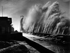 Threatening waves crash against a sea wall around the 6000 block of East Ocean Boulevard in Belmont Shore, a neighborhood in Long Beach. Dated: 1939.(LAPL) Bizarre Los Angeles