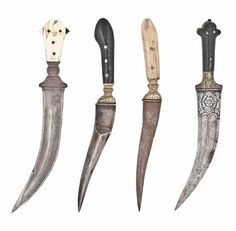 A GROUP OF FOUR DAGGERS   INDIA, LATE 18TH/EARLY 19TH CENTURY   Comprising two jambiyyas, the first with ivory hilt and watered-steel blade with double fuller, the second with double-fuller blade with floral decoration engraved to the forte and gold-damascened floriated scrolling vine to the bolster and tang, and two gold-damascened short daggers with reinforced drop-point tip, the decoration with foliated motifs to the bolster and tang, the first ivory-hilted, the second horn-hilted