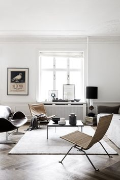 Bright and modern living room with stylish design furniture in natural materials.