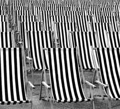 Beach wedding, black | white deck chairs for ceremony seating