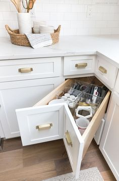 A super smart solution for using the corner space in a kitchen - kitchen corner drawers! Love all of the other organizing idea in this post too! #kitchenorganization #kitchenrenovation #kitchenremodel