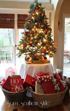 Savvy Southern Style: Tis The Season - Just a pic but I love the idea of using baskets to organize gifts under the tree... 1) need to take them to several different parties? 2) each family member gets their own basket? 3) don't have to climb under the tree to find the one way in the back. Lots of ideas for this basket pic