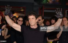 News Photo : Musician/poet Lou Reed puts his handprints in...