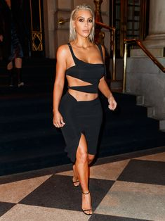 Kim Kardashian West Places a Sexy Spin on the LBD | On Thursday, Kim Kardashian sizzled in an ab-flaunting LBD. See her look here.
