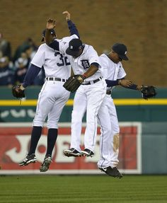 Detroit Tigers' Don Kelly, Torii Hunter, middle, and Austin Jackson celebrate after Game 4 of the American League baseball championship seri...